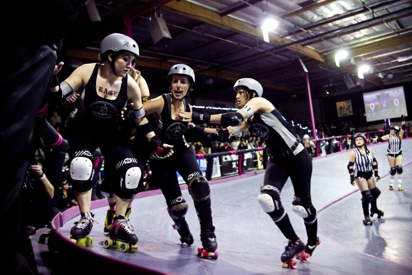 """The Ri-Ettes, a member of the Los Angeles Derby Dolls roller derby league, battle the Pennsylvania All Star Rollers at the """"Doll Factory"""" in L.A.'s Historic Filipinotown. The Ri-Ettes prevailed."""