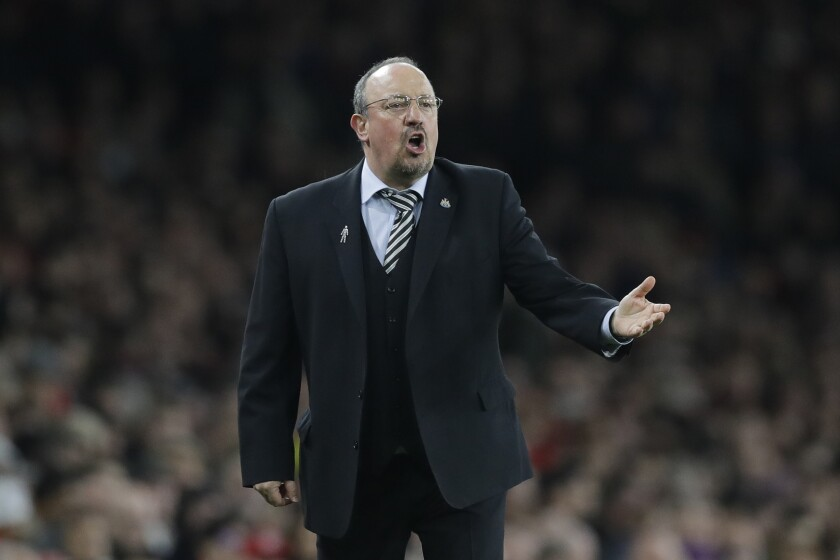 FILE - In this file photo dated Monday, April 1, 2019, Newcastle's manager Rafael Benitez during the English Premier League soccer against Arsenal at Emirates stadium in London. Away from the Premier League's title favorites stands a collection of outsiders looking to push into European contention or solidify themselves as established members in the world's richest league. Is the marriage of Everton and its newly appointed manager Rafa Benitez heading for a quick divorce? (AP Photo/Kirsty Wigglesworth, FILE)