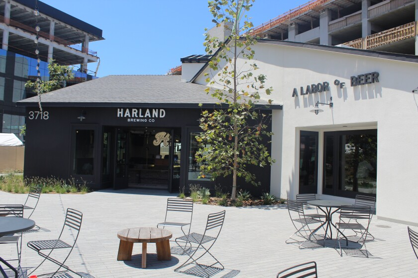Harland is bordered by office buildings and residential units, still under construction at One Paseo.