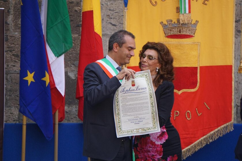 Naples' Mayor Lugi De Magistris confers the honorary citizenship certificate to Sophia Loren during a ceremony in Naples, Italy, Saturday, July 9, 2016. (Cesare Abbate/ANSA Via AP)