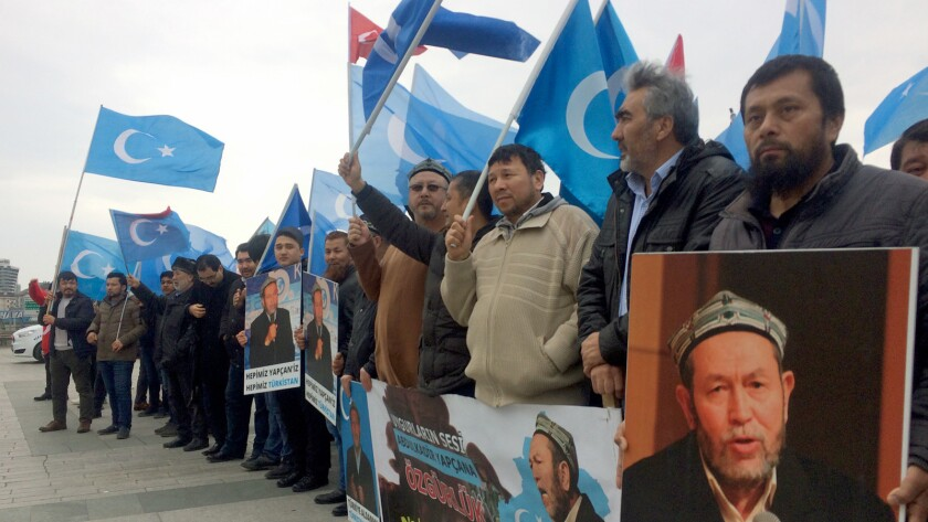 Uighurs protest outside an Istanbul courtroom in support of Abdulkadir Yapcan, who faces extradition