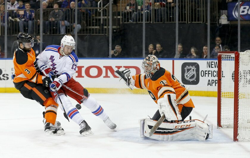 New York Rangers right wing Kevin Hayes (13) tries to score on the rebound of a shot blocked by Philadelphia Flyers goalie Steve Mason (35) as defenseman Radko Gudas (3) helps defend during the second period of an NHL hockey game, Sunday, Feb. 14, 2016, in New York. (AP Photo/Julie Jacobson)
