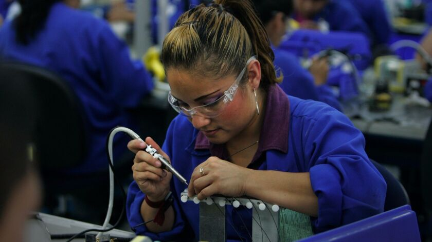 A worker at Plantronics, a maquiladora in Tijuana that makes headsets.