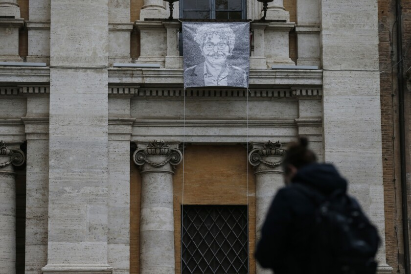 FILE - In this Monday, Jan. 25, 2021 file photo, a giant portrait of activist and researcher Patrick George Zaki, hangs from the facade of Rome's Capitol Hill. Italian lawmakers have given final approval to a motion calling on Italy's government to grant citizenship to an Egyptian student, enrolled in an Italian university, who has been jailed in Cairo for nearly one year and a half. Egyptian courts have repeatedly extended the detention in jail of Patrick Zaki, a human rights activists since he was jailed in February 2020 after arriving in his homeland to visit family. (Cecilia Fabiano/LaPresse via AP)