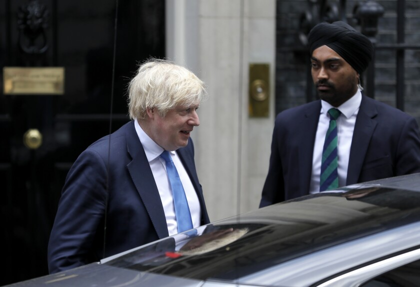 Britain's Prime Minister Boris Johnson leaves 10 Downing Street to attend the weekly session of Prime Ministers Questions in Parliament in London, Wednesday, June 17, 2020. (AP Photo/Kirsty Wigglesworth)