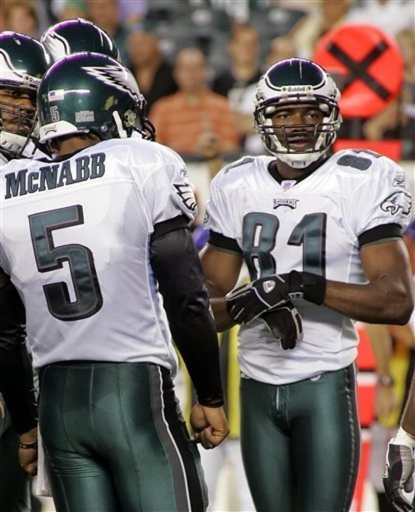 "FILE - This Aug. 26, 2005, file photo shows Philadelphia Eagles quarterback Donovan McNabb (5) and Eagles receiver Terrell Owens (81) waiting for play to resume against the Cincinnati Bengals in the first quarter of an NFL football game in Philadelphia. McNabb and Owens are teaming up on a basketball court instead of a football field in the new season of Spike TV's ""Pros vs. Joes."" (AP Photo/Rusty Kennedy, File)"