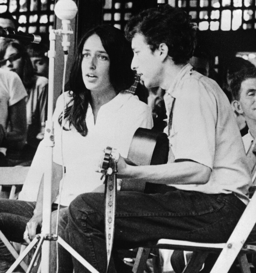 FILE - In this 1963 file photo, Joan Baez and Bob Dylan perform at the Newport Jazz Festival in Newport, R.I. Two years later, on the night of July 25, 1965, Dylan strode onto a stage at the Newport Folk Festival, plugged in an electric guitar and gave the music world a shock. Fifty years later, it's considered one of the most important events in rock history, the high-voltage moment when Dylan broke from folk and helped show his fellow musicians the poetic possibilities of rock. (AP Photo, File)