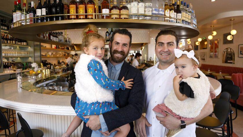 CARLSBAD, CA 12/18/2018: Owner John Resnick, left, holding his daughter, four-year-old, Elsie June R