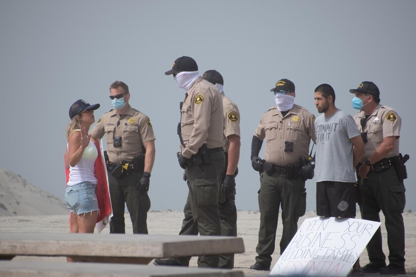Crista Curtis speaks with San Diego County Sheriff's deputies on April 25 at a rally in Encinita's California.