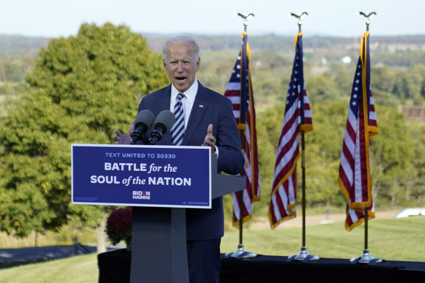 """Joe Biden speaks at Gettysburg National Military Park in Pennsylvania with the sign: """"Battle for the soul of the nation."""""""
