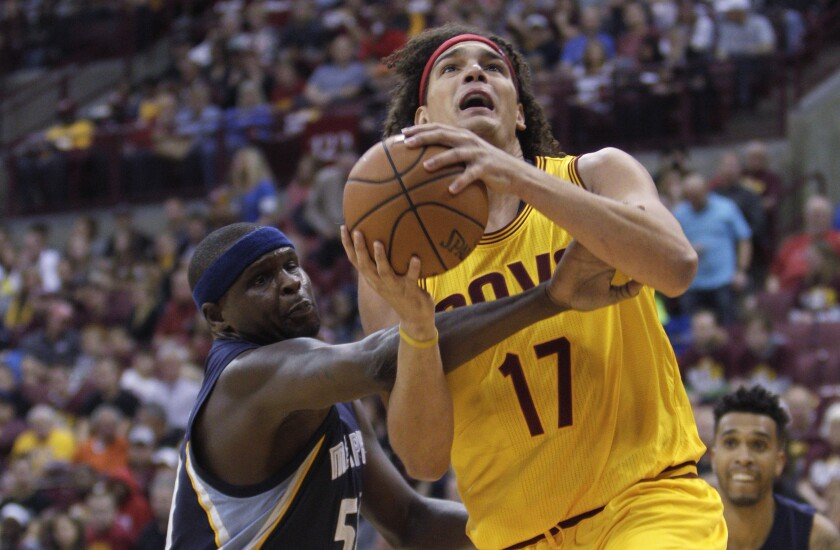FILE - In this Oct. 12, 2015, file photo, Memphis Grizzlies' Zach Randolph, left, fouls Cleveland Cavaliers' Anderson Varejao during the first quarter of an NBA preseason basketball game in Columbus, Ohio. The Cavaliers have considered re-signing former center Varejao for the remainder of the season, a person familiar with the team's thinking told the Associated Press on Friday, April 30, 2021. (AP Photo/Jay LaPrete, FIle)