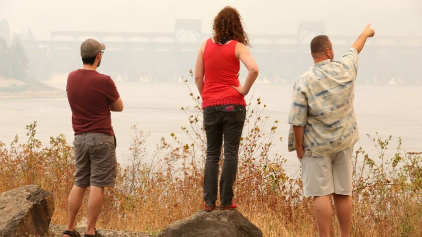 People check out the smoky view of the Eagle Creek fire from North Bonneville Dam in the Columbia Ri