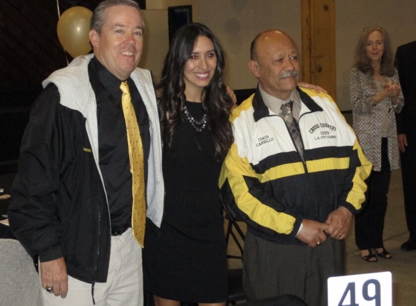 Bruce Thomson, left, was inducted into the San Pedro sports Hall of Fame. He died Tuesday. He was 61.
