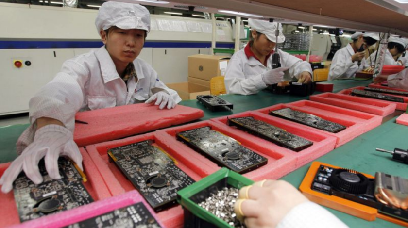 Foxconn employees assemble Apple iPhones at a factory in Shenzen, China.