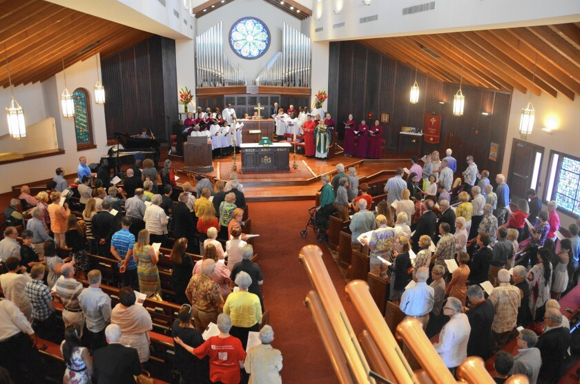 The congregation at St. James the Great Episcopal Church in Newport Beach gathers Sunday for what was expected to be the last service at the church's current location at 3209 Via Lido.