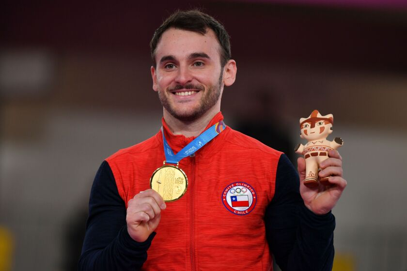 Chile's Enrique Tomas Gonzalez poses on the podium with the gold medal after winning the Artistic Gymnastics Men's Floor Exercise Final during the Lima 2019 Pan-American Games in Lima, on July 30, 2019. (Photo by Luis ACOSTA / AFP)LUIS ACOSTA/AFP/Getty Images ** OUTS - ELSENT, FPG, CM - OUTS * NM, PH, VA if sourced by CT, LA or MoD **