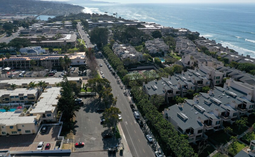 An aerial view of the site of a proposed affordable housing project near million-dollar condos in Solana Beach in San Diego County. It's a 10-unit project that has been in the works for the last decade and has yet to break ground.