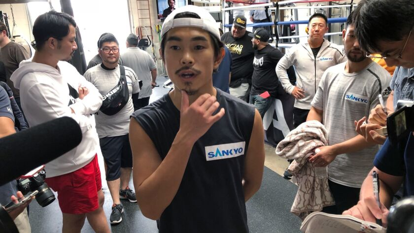 Super flyweight Kazuto Ioka, of Japan, ponders a question from reporters at the Wild Card West gym i