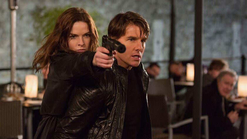 In this image released by Paramount Pictures, Rebecca Ferguson, left, and Tom Cruise appear in a sce