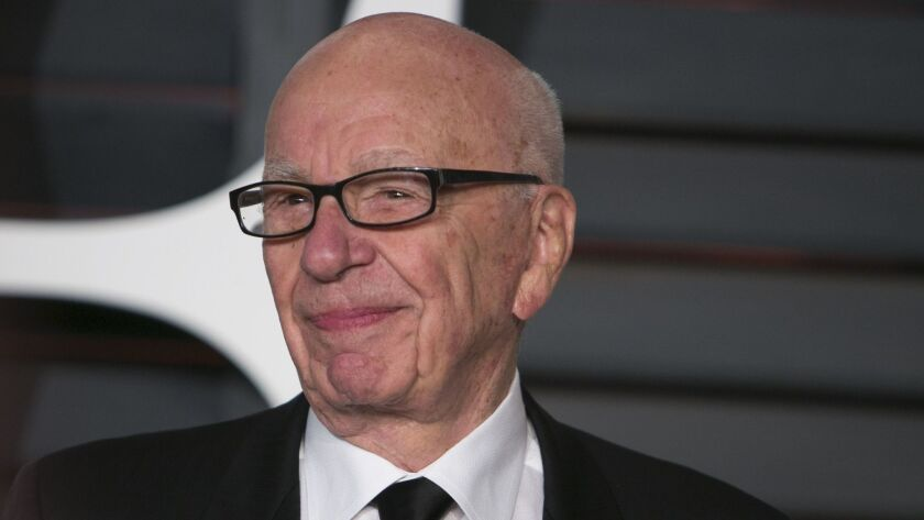 (FILES) This picture taken on February 22, 2015 shows Rupert Murdoch arriving at the 2015 Vanity Fai
