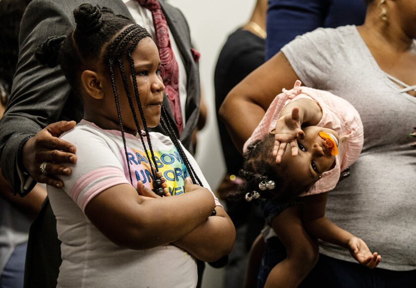 Blessen Miller, 8, left, and her sister, Memory, at a news conference held by Rayshard Brooks' family   Monday in Atlanta.