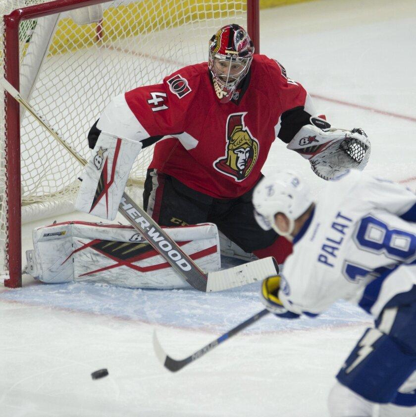 Tampa Bay Lightning left wing Ondrej Palat (18) takes a shot on Ottawa Senators goalie Craig Anderson during second period of NHL hockey action in Ottawa, Canada, Monday, Feb. 8, 2016. (Adrian Wyld/The Canadian Press via AP) MANDATORY CREDIT