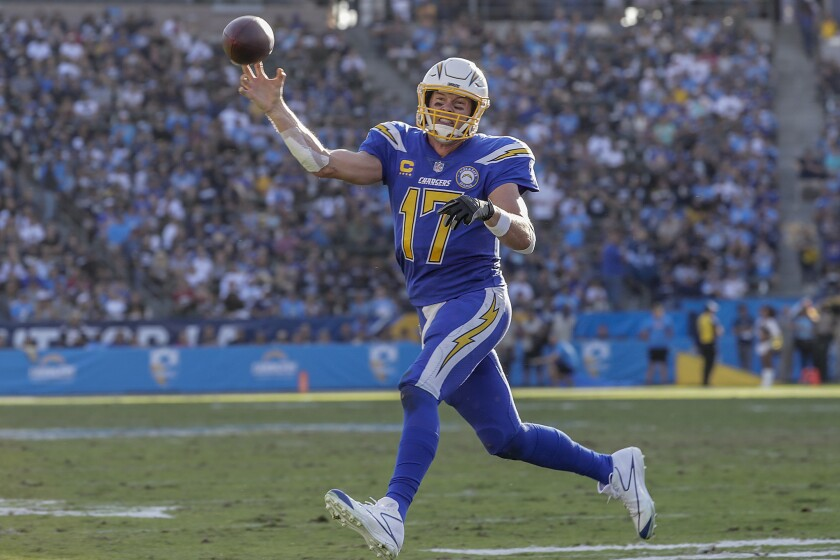 Chargers quarterback Philip Rivers rolls out to throw a four-yard touchdown pass to Keenan Allen in the third quarter against the Arizona Cardinals at StubHub Center.