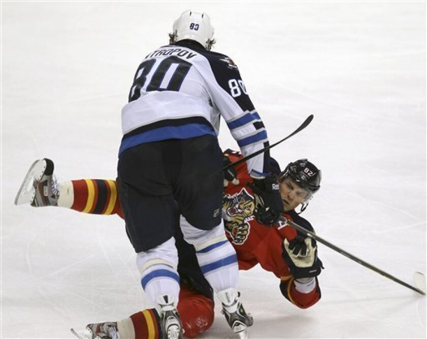 Winnipeg Jets' Nik Antropov (80) knocks Florida Panthers' Tomas Kopecky (82) to the ice during the third period of an NHL hockey game in Sunrise, Fla., Tuesday, April 3, 2012. The Jets won 5-4 in overtime. (AP Photo/J Pat Carter)