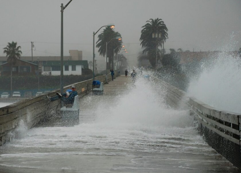 A high surf advisory also is still in effect. Photographer Jim Grant took this shot early Wednesday at Ocean Beach.