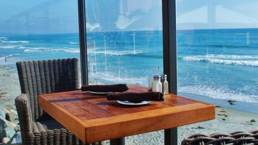 Table with a view at Pacific Coast Grill in Cardiff, which was recently named to OpenTable's 2018 list of America's 100 most scenic restaurants.