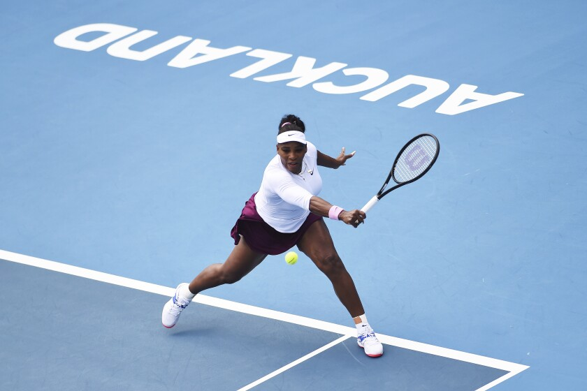 United States' Serena Williams makes a return during her match against Italy's Camila Giorgi at the ASB Classic in Auckland, New Zealand, Tuesday, Jan. 7, 2020. (Chris Symes/Photosport via AP)