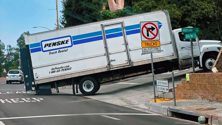 "Yet Another Stuck Truck — La Jolla Light reader Carl Doughty supplies this photo and writes: ""Despite flashing warnings and signs along both lanes of Torrey Pines Road advising truck drivers not to attempt turning onto Hillside Drive, this truck was spotted the morning of Nov. 11, 2019 doing just that."""