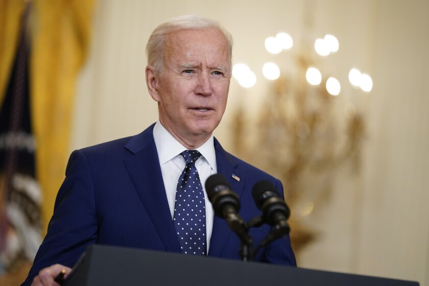 President Biden at a lectern with microphones