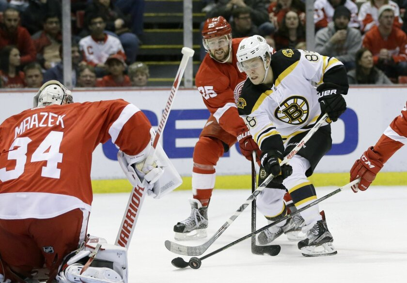 Boston Bruins left wing David Pastrnak (88) of the Czech Republic shoots on Detroit Red Wings goalie Petr Mrazek (34) of the Czech Republic during the first period of an NHL hockey game, Sunday, Feb. 14, 2016, in Detroit. (AP Photo/Carlos Osorio)