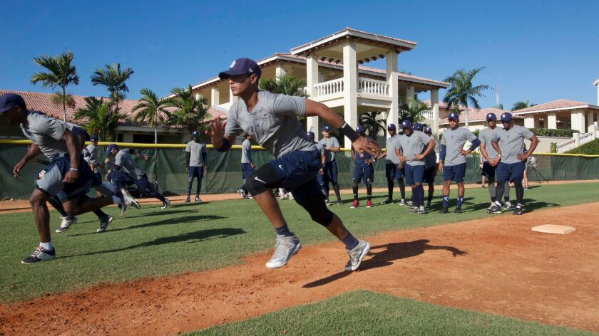 Mid-morning base running drills at the Padres baseball academy in San Cristobal, in the Dominican Republic.
