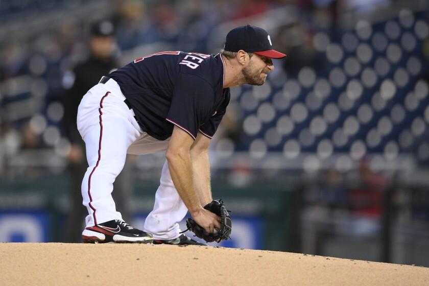 Washington Nationals starting pitcher Max Scherzer stretches on the mound during June game.