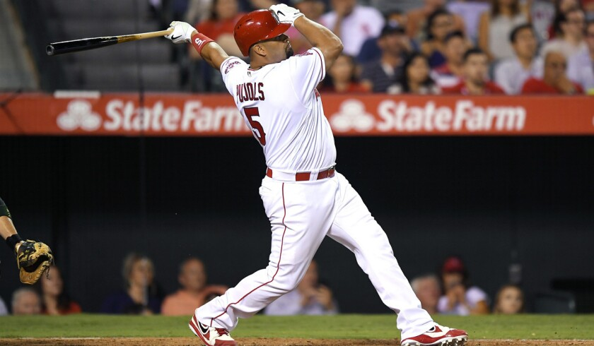 Angels' Albert Pujols follows through on a walk-off two-run home run against the Oakland Athletics on Wednesday.