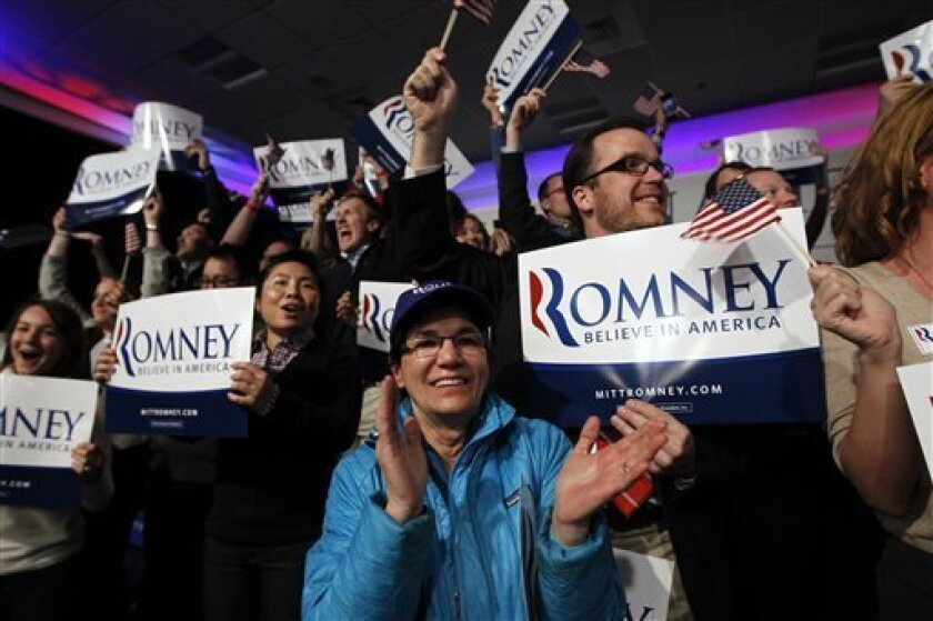 Supporters of Republican presidential candidate, former Massachusetts Gov. Mitt Romney, react as it was declared that he was the winner of the New Hampshire primary election at his reception in Manchester, N.H., Tuesday, Jan. 10, 2012. (AP Photo/Charles Dharapak)