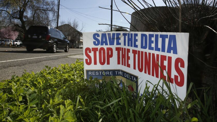 FILE - In this Feb. 23, 2016, file photo, a sign opposing a proposed tunnel plan to ship water throu