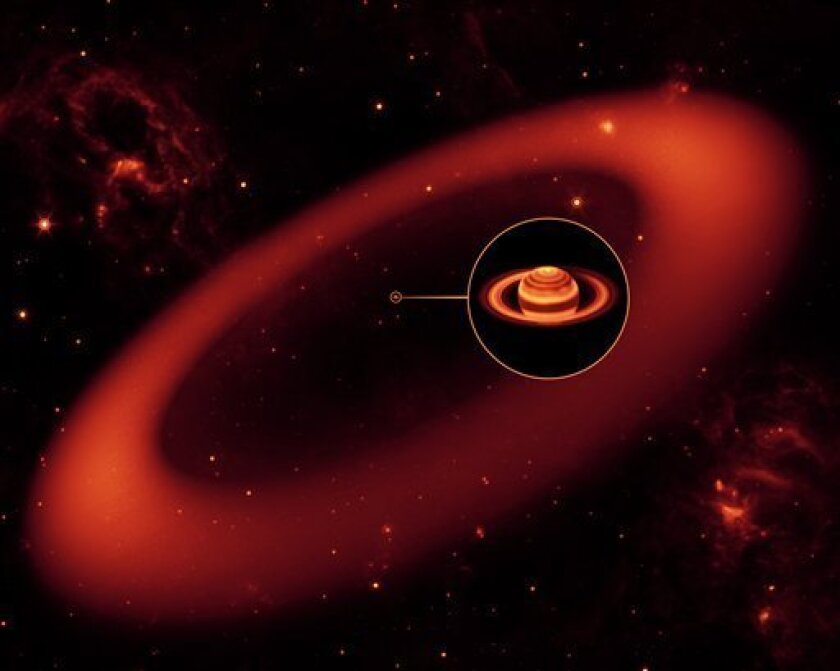 This artist's rendering released by NASA's Jet Propulsion Laboratory on Tuesday Oct. 6, 2009 shows the biggest but never-before-seen ring around Saturn, spotted by NASA's Spitzer Space Telescope. (AP Photo/Artist's Rendering courtesy NASA's Jet Propulsion Laboratory)