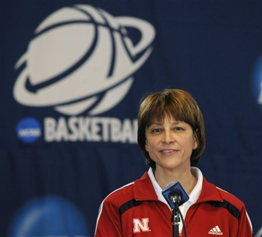 FILE- This March 22, 2010 file photo shows Nebraska head coach Connie Yori answering questions from the media during an NCAA college basketball news conference in Minneapolis. Yori was hospitalized most of September following complications from what was supposed to be a simple knee surgery. A staph infection and blood clot in the knee caused so much pain that she passed out and had to be rushed to the hospital by ambulance. (AP Photo/Hannah Foslien, File)