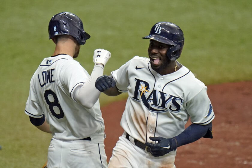 Tampa Bay Rays' Randy Arozarena celebrates his solo home run off New York Yankees starting pitcher Domingo German with second baseman Brandon Lowe (8) during the third inning of a baseball game Saturday, April 10, 2021, in St. Petersburg, Fla. (AP Photo/Chris O'Meara)