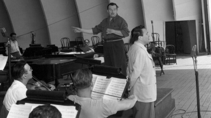 Xavier Cugat conducting a rehearsal at the Hollywood Bowl with Desi Arnaz.