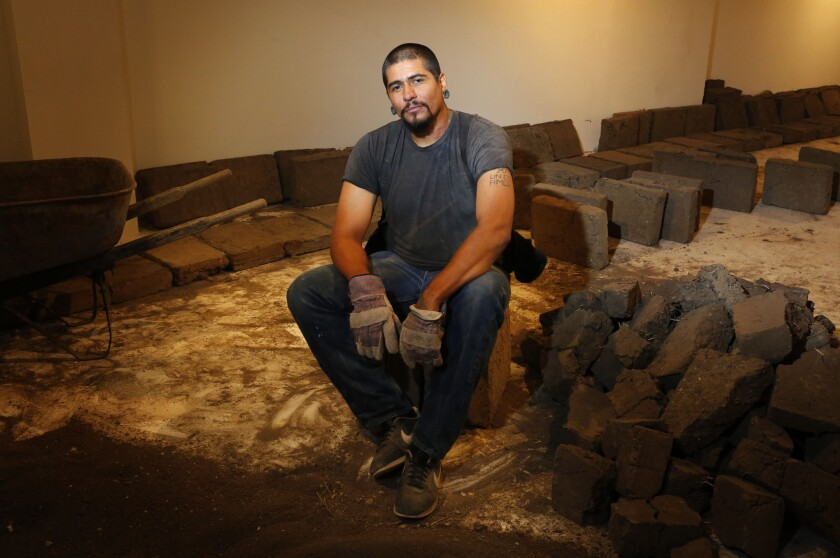 L.A. performance artist Rafa Esparza has crafted thousands of adobe bricks that he is using to build an elliptical structure inside the galleries of Los Angeles Contemporary Exhibitions (LACE) in Hollywood.