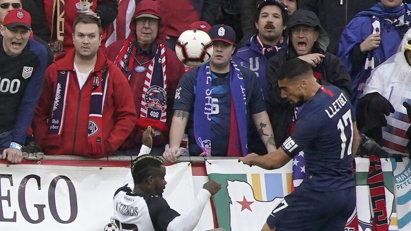 United States defender Sebastian Lletget, right, scores a goal over Costa Rica defender Waylon Francis in the second half Saturday.