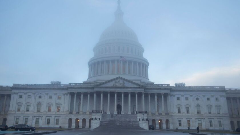 The Capitol Building in Washington, D.C. is partially shrouded in fog just after dawn on Jan. 4.