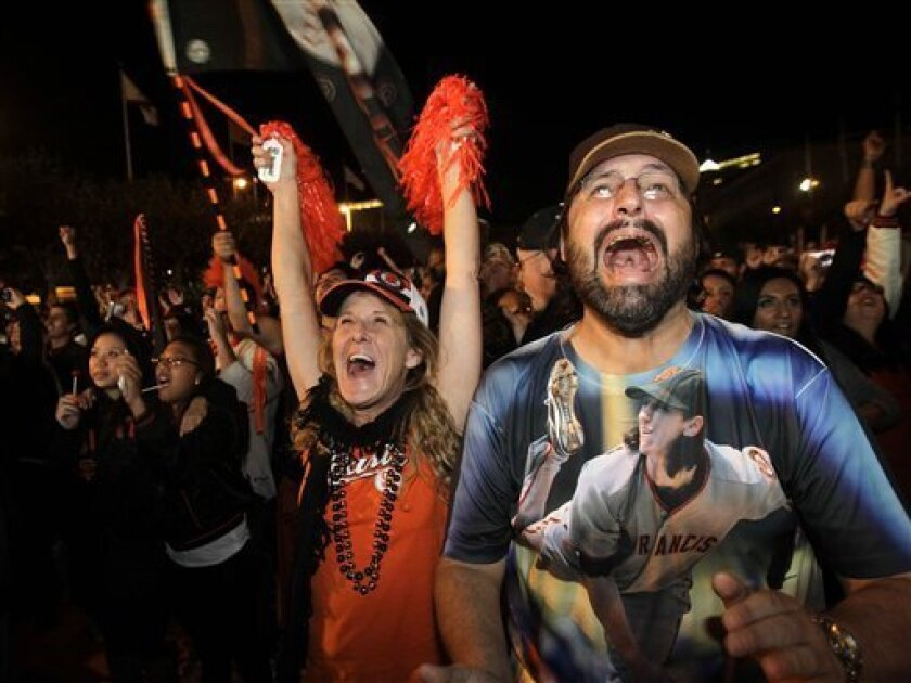 Fans celebrate as the San Francisco Giants beat the Texas Rangers to win the World Series at Civic Center Plaza in San Francisco, Monday, Nov. 1, 2010. (AP Photo/Marcio Jose Sanchez)