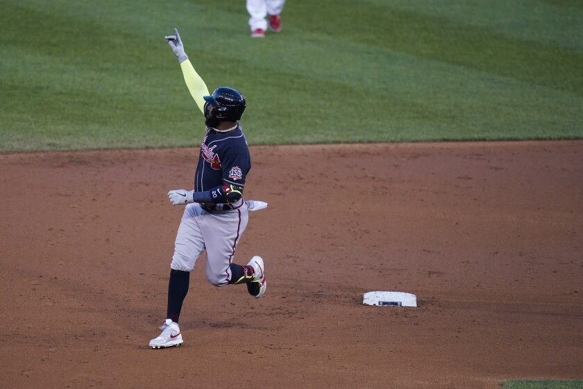 Atlanta Braves' Marcell Ozuna celebrates as he runs the bases on a grand slam during the third inning of the team's baseball game against the Washington Nationals at Nationals Park, Wednesday, May 5, 2021, in Washington. (AP Photo/Alex Brandon)