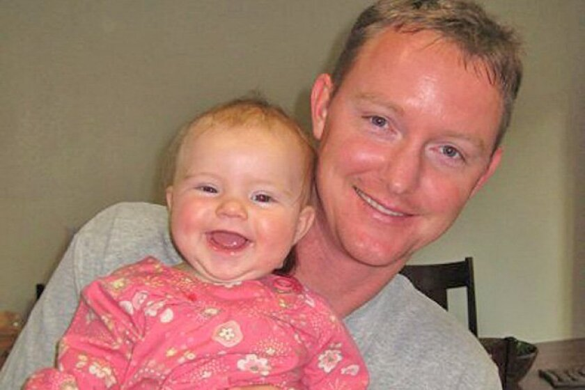 Lt. Cmdr. Che J. Barnes holds his niece Imogen in an undated family photo. Barnes commanded the Coast Guard HC-130 Hercules plane that collided with a Camp Pendleton helicopter the night of Oct. 29.