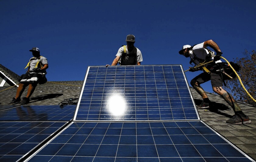 California is the nation's largest market for solar because of abundant sunshine and statewide efforts to encourage green energy. Above, a crew installs solar panels at a home in Camarillo.